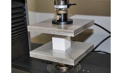 Testing equipment in Cellofoam's laboratory - close-up of compression testing using ASTM D1621 Standard Test Method for Compressive Properties of Rigid Cellular Plastics