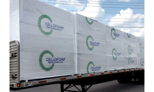 Large Flat sheets of EPS Foam insulation shown in bags with Cellofoam logo on flatbed truck