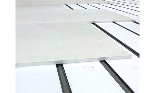 FR Composite installed over Flute Fill in a metal re-roofing application