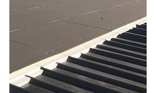 Flute Fill in a metal re-roofing application
