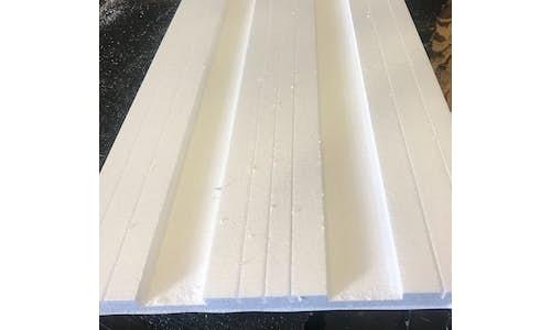 Garage door insulation with facer for garage door manufacturers