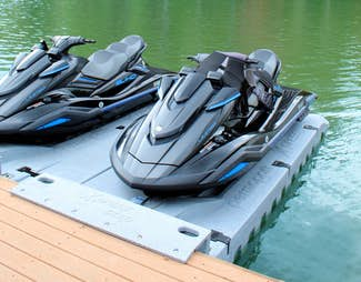 Jetski launches on a lake-side deck