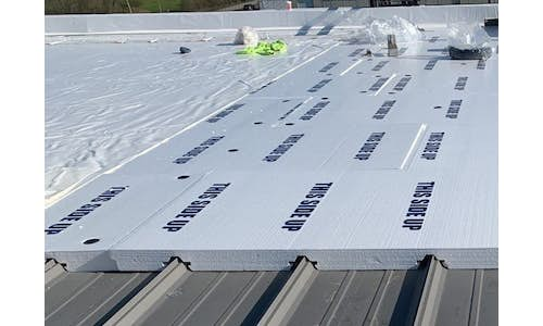 Cellofoam Laminated Flute Fill Combo Board with Polyester Facer installed on a roof
