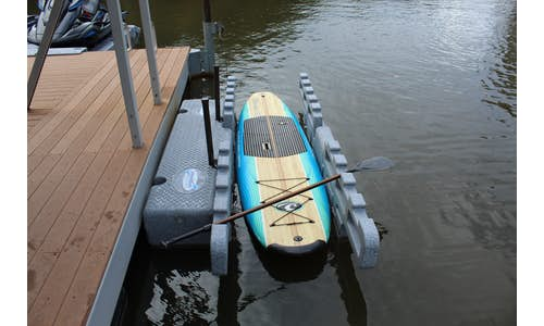 Photo of a Permalaunch kayak port with a stand-up paddleboard