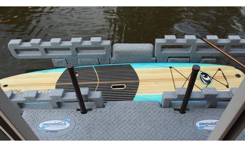 Photo of a Permalaunch kayak dock with a stand-up paddleboard