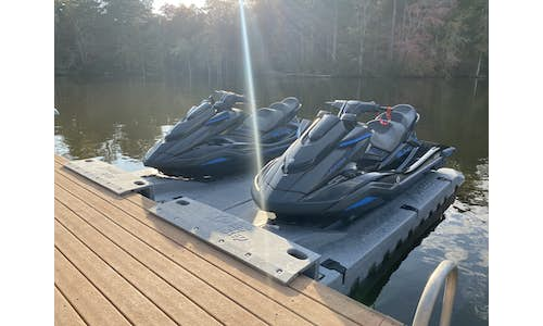 Photo of two Permaport Xpress drive-on jet ski docks mounted side-by-side