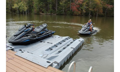 Photo of two Permaport Xpress drive-on PWC ports mounted side-by-side with jet ski about to drive on