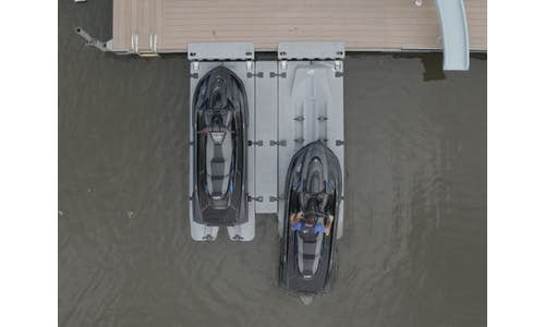 Top view photo of two Permaport Xpress drive-on PWC docks mounted side-by-side with PWC driving on